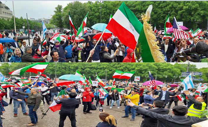 افراشتن پرچم آمریکا و اسرائیل درلابلای صدها درفش شیرخورشید نشان ایران
